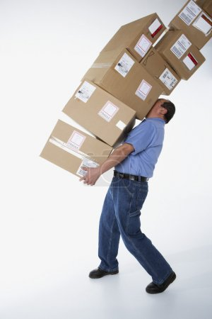 Studio shot of male warehouse worker carrying packages