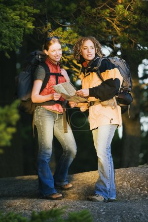 Female hikers consulting a map