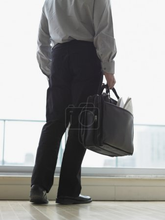 Young businessman carrying his briefcase