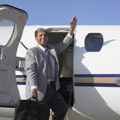 Indian businessman boarding airplane
