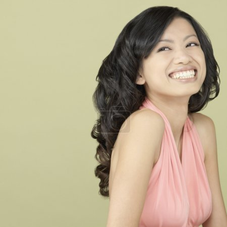 Studio shot of Asian woman laughing