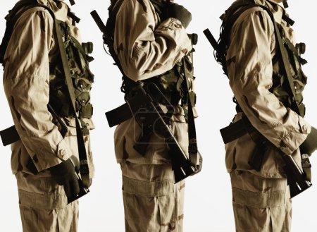 Studio shot of three soldiers