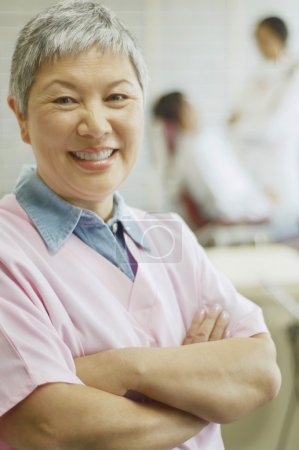 Senior Asian female dental assistant smiling