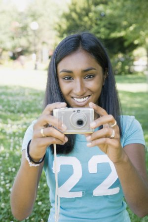 Indian woman taking photograph