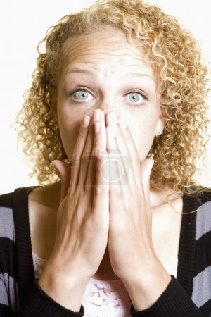 Woman covering her mouth in surprise