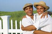 Hispanic twin brothers hugging