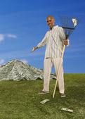 Man raking large pile of dollar bills