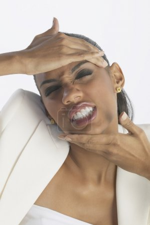 African businesswoman pulling on head