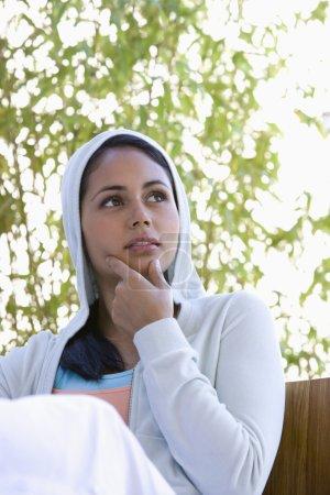 Young woman wearing hooded sweatshirt
