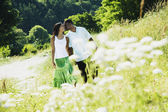 African couple walking in park