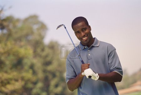 African American man holding golf club