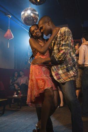 African couple dancing at nightclub