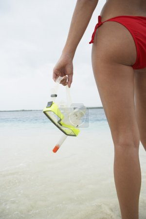 South American woman holding snorkeling gear