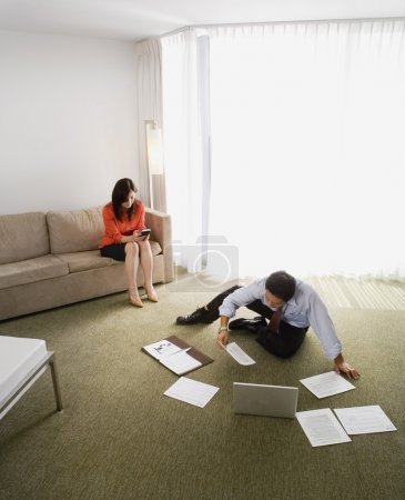 Asian businesspeople working in hotel room
