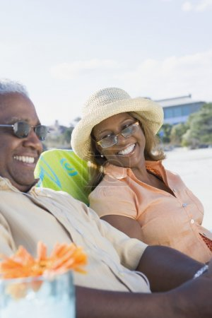 African couple laughing at beach