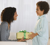 African mother and son exchanging gift