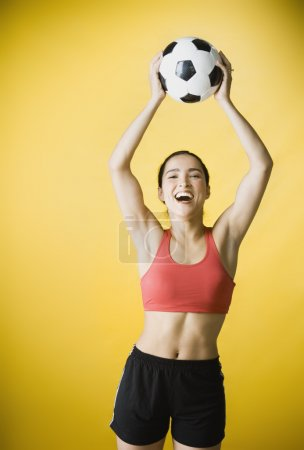 Hispanic woman holding soccer ball