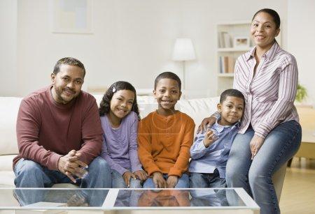 Mixed Race family sitting on sofa