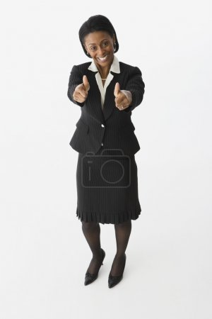 African businesswoman giving thumbs up