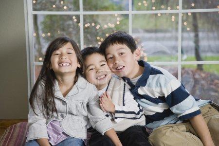 Mixed Race siblings hugging