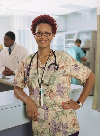 African female nurse leaning on counter