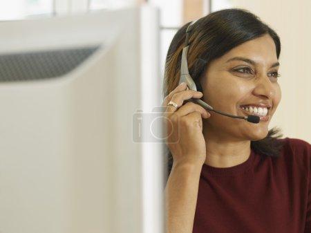 Indian businesswoman wearing headset