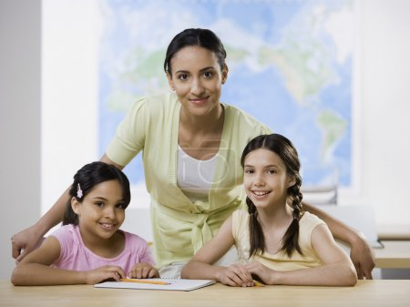 Mixed Race female teacher and multi-ethnic female students