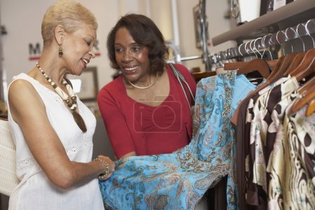 Senior African American women clothes shopping