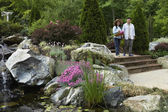 Senior Asian couple in garden
