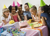 Multi-ethnic girls at birthday party
