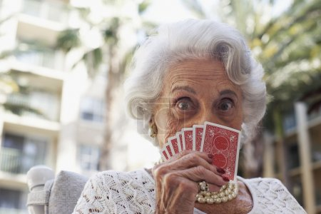 Senior woman playing cards