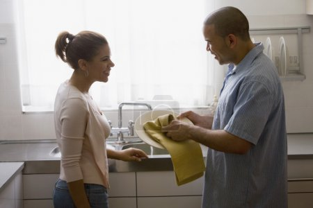 African American couple drying dishes