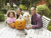 African family with jack-o-lantern