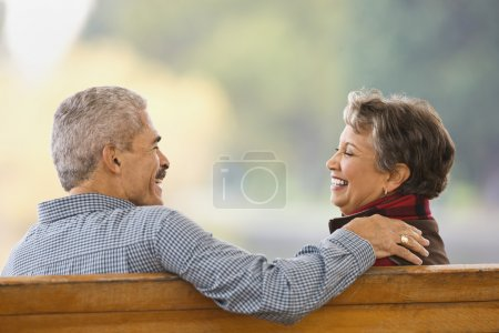 African couple sitting on bench