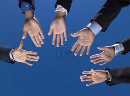 Business is hands outstretched in circle