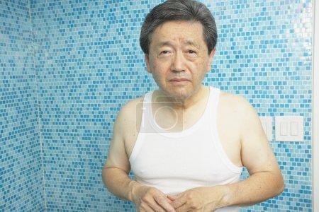 Worrying Asian man in bathroom
