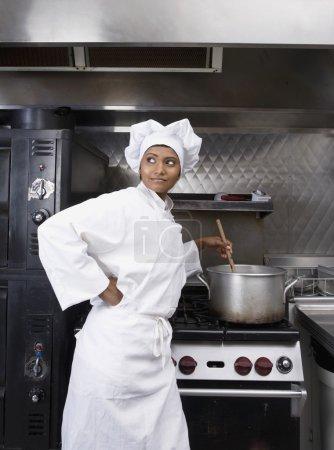Mixed Race female chef preparing food