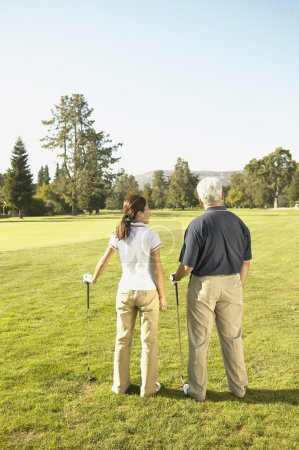 Asian couple on golf course