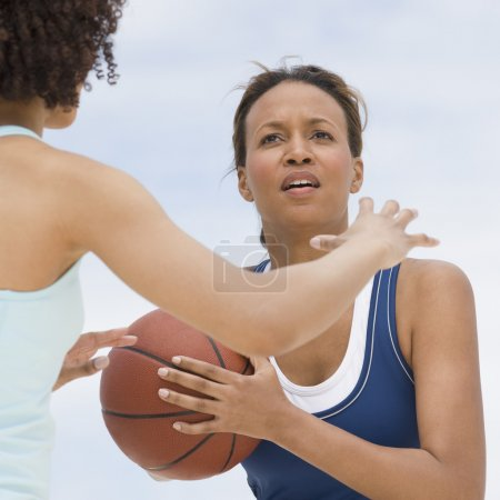 African women playing basketball