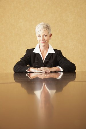 Senior businesswoman sitting at table