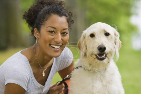 African American woman with dog