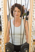 Senior woman sitting in exercise equipment