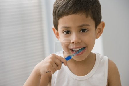 Hispanic boy brushing teeth