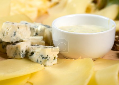 Photo for Various types of cheese on wooden platter - Royalty Free Image