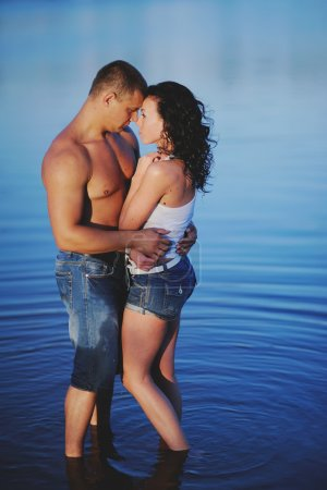 Sweet couple in river bonding