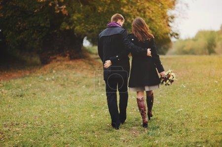 young couple walking away