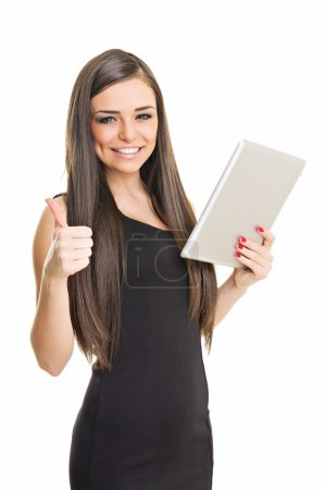Attractive businesswoman using tablet computer showing thumb up