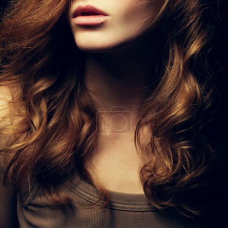 Photo for A Beautiful red-haired girl's portrait. Natural hairstyle. Healthy Hair. Close up. Studio shot - Royalty Free Image