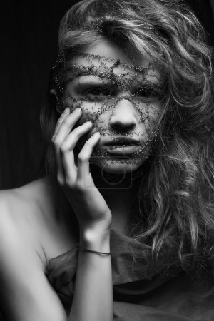 Skin care concept. Nightmare of a young glamourous blonde woman