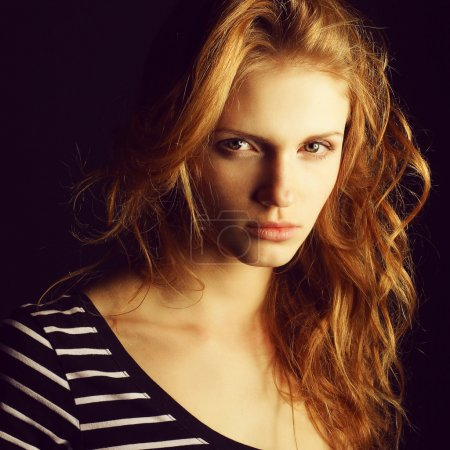 Portrait of a fashionable red-haired (ginger) model in t-shirt w